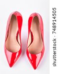 ladies red heels  top view.... | Shutterstock . vector #748914505