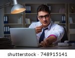 businessman staying late in... | Shutterstock . vector #748915141