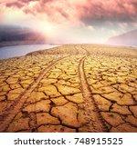 traces of wheels in the desert...   Shutterstock . vector #748915525