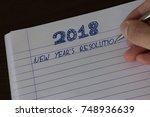 hand writing 2018 new year's... | Shutterstock . vector #748936639
