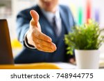 man in suit and tie give hand... | Shutterstock . vector #748944775