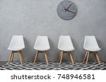 row of empty white chairs in a... | Shutterstock . vector #748946581