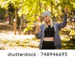 the girl has lost a mobile... | Shutterstock . vector #748946695