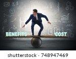 businessman balancing between... | Shutterstock . vector #748947469