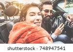 happy trendy couple having fun... | Shutterstock . vector #748947541
