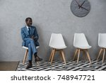 handsome middle aged african... | Shutterstock . vector #748947721