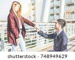 asian boyfriend holding... | Shutterstock . vector #748949629