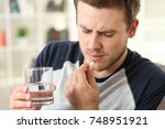 man suffering taking a pill... | Shutterstock . vector #748951921