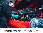 electic car with open hood....   Shutterstock . vector #748953079