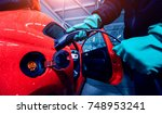 charging an electric vehicle in ... | Shutterstock . vector #748953241