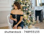 young beautiful girl in a black ... | Shutterstock . vector #748955155
