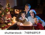 christmas night. looking at... | Shutterstock . vector #748968919
