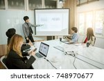 businessman standing in front... | Shutterstock . vector #748970677