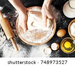 making dough by female hands at ... | Shutterstock . vector #748973527