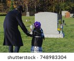 grandfather and granddaughter... | Shutterstock . vector #748983304