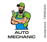 auto mechanic in a cap with a... | Shutterstock .eps vector #749001031