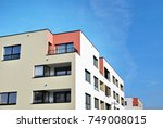 modern apartment buildings on a ... | Shutterstock . vector #749008015