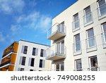 modern apartment buildings on a ... | Shutterstock . vector #749008255