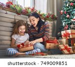 merry christmas and happy... | Shutterstock . vector #749009851