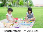 asian child happy play toy in... | Shutterstock . vector #749011621