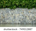 Old Stone Wall With Palm Leaf...