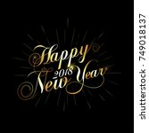golden happy new year on black... | Shutterstock .eps vector #749018137