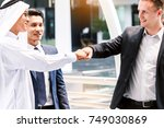 businessman and partner giving... | Shutterstock . vector #749030869