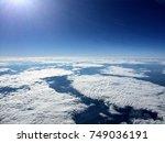 broken cloud layer with deep... | Shutterstock . vector #749036191