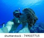 underwater wide angle selfie of ... | Shutterstock . vector #749037715