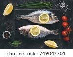 fresh sea beam or dorado fish ... | Shutterstock . vector #749042701