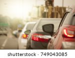 cars on the road heading... | Shutterstock . vector #749043085