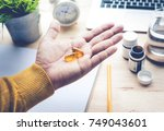 male eating medicine pill ... | Shutterstock . vector #749043601