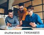 happy male colleagues having... | Shutterstock . vector #749044855