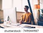pensive male it developer... | Shutterstock . vector #749044987