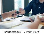 customers are getting money... | Shutterstock . vector #749046175