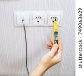 electrician testing for... | Shutterstock . vector #749063629