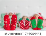 happy family lying on bed.... | Shutterstock . vector #749064445