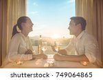 romantic couple having dinner... | Shutterstock . vector #749064865
