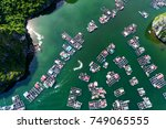 floating fishing village and... | Shutterstock . vector #749065555