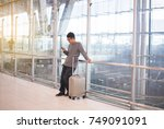 asian man traveler using 5g in... | Shutterstock . vector #749091091
