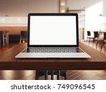 laptop on the table in loft... | Shutterstock . vector #749096545