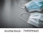 sterile flu masks on grey... | Shutterstock . vector #749099665