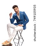 seated fashion model is posing... | Shutterstock . vector #749105935