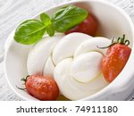 string mozzarella and tomatoes   Shutterstock . vector #74911180