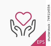 hands with a heart icon on... | Shutterstock .eps vector #749114554