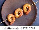 tiger shrimp on skewer in plate.... | Shutterstock . vector #749116744