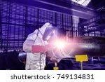 worker welding in steel pipe in ...   Shutterstock . vector #749134831