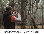 young boy takes photo with... | Shutterstock . vector #749153581