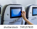 traveling airplane and using... | Shutterstock . vector #749157835