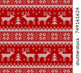 knitted seamless pattern with... | Shutterstock .eps vector #749161624